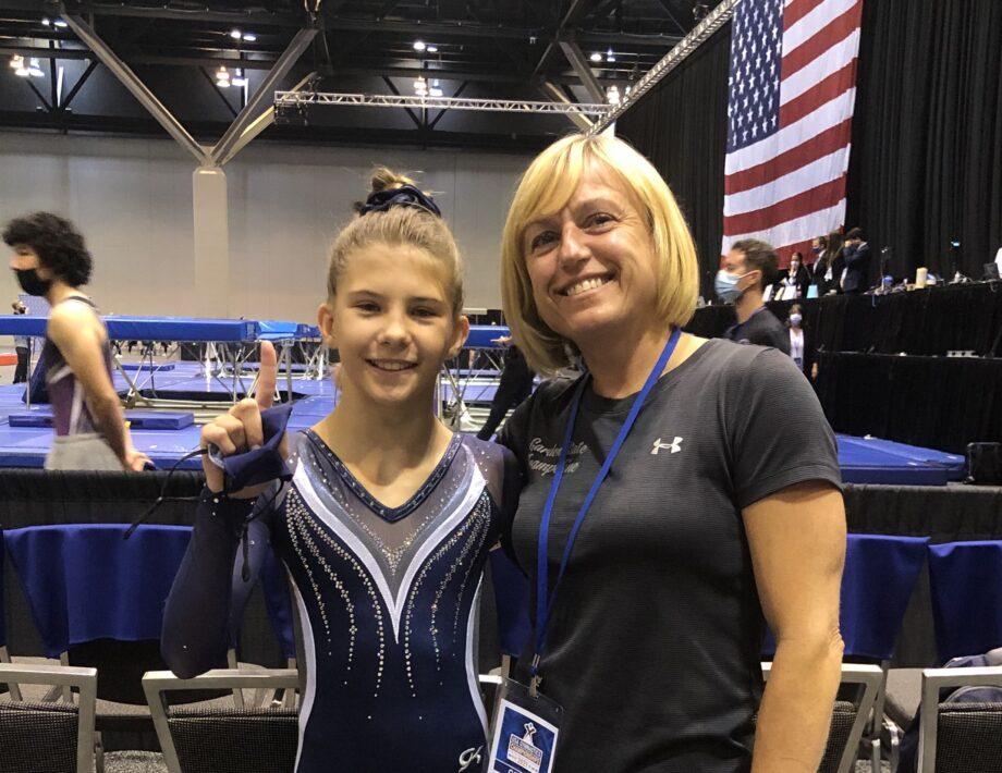 Coach Natasha and a gymnast.