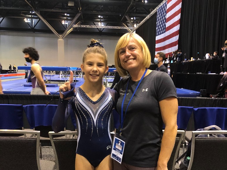Coach Natalia and a student at championships cropped.