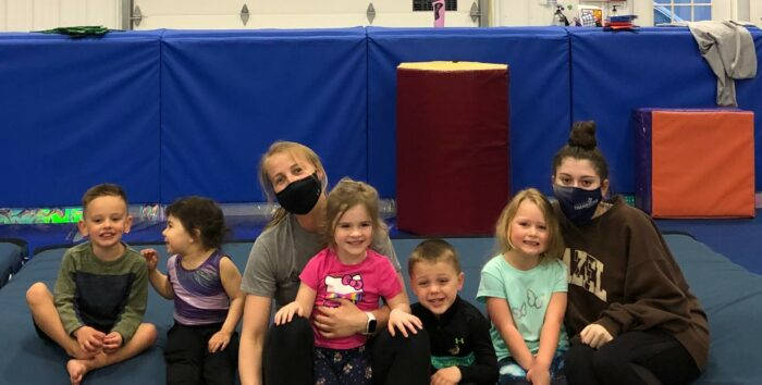 Coach Nastia and several kids after a gym practice.