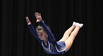 A girl in the air mid-flip.