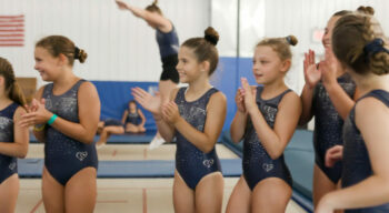 girls clapping in unitards.