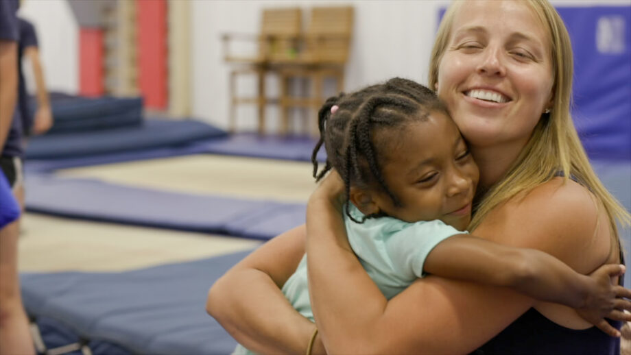 nastia and a girl hugging.