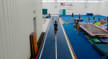 a girl running into a cartwheel.